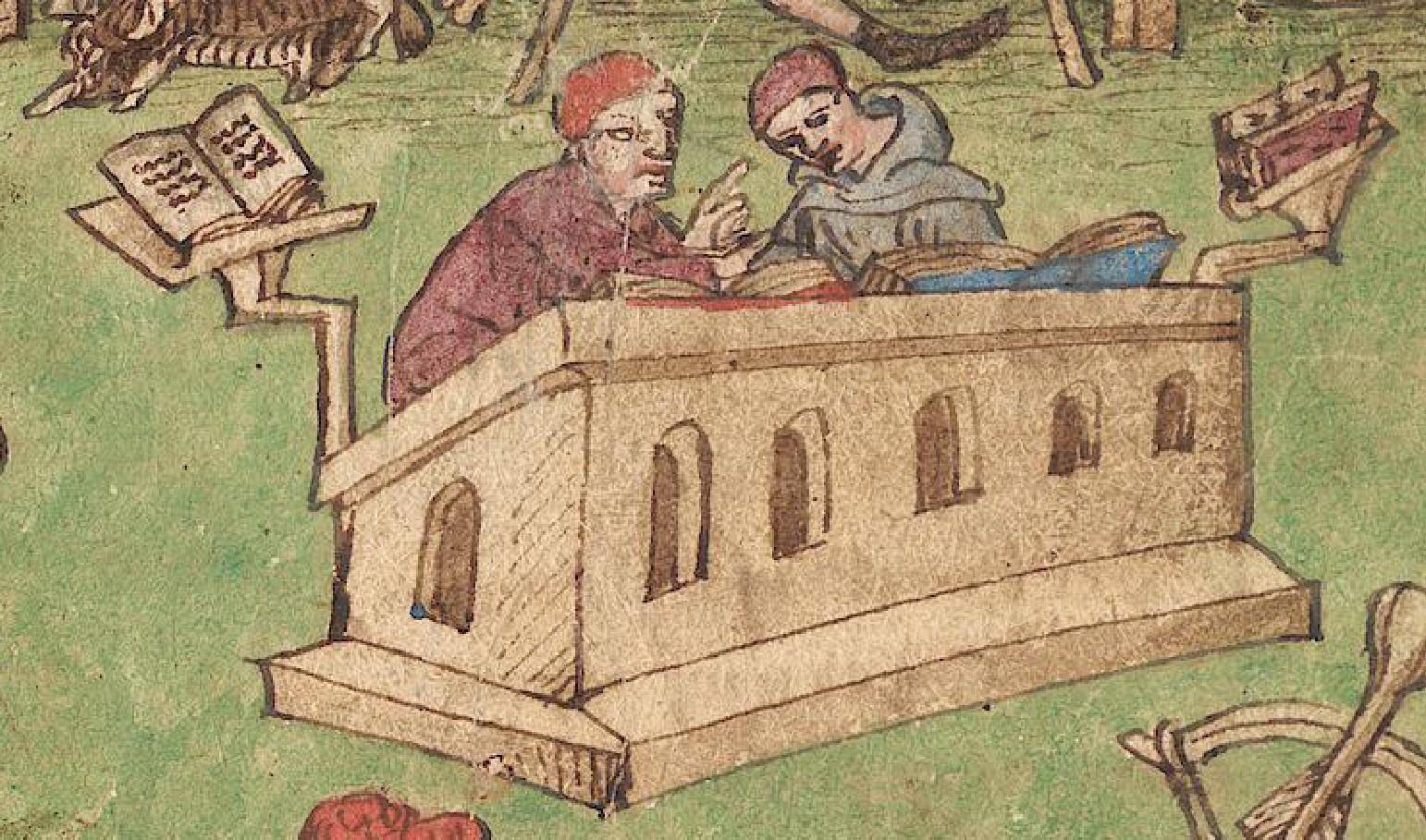 Zwei Männer diskutieren hinter einem Büchertisch.